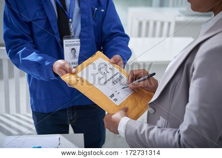 Business lady writing shipping address on package