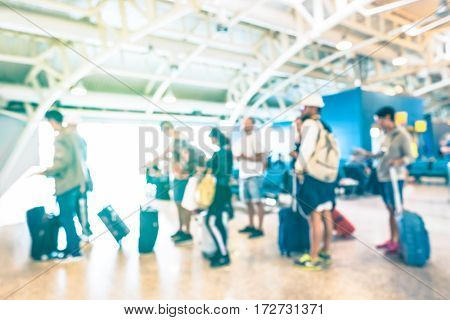 Blurred defocused people waiting in queue at terminal gate of international airport for airplane trip - Travel wanderlust concept on passengers with suitcase luggage backpack - Azure sunshine filter