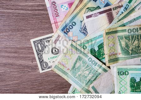 Old Belarusian money and a dollar. The course of the Belarusian money currency devaluation.