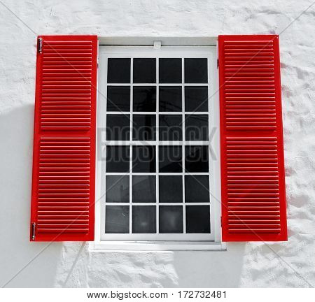 Close up of bay window with red shutters