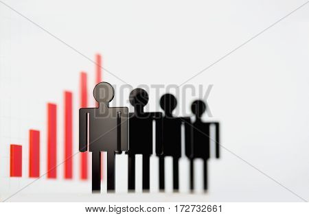 Silhouettes of business people located on the background of infographics. The image depth of field