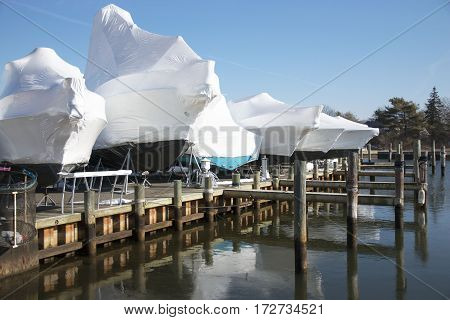 Boats shrink wrapped and stored on the docks for winter