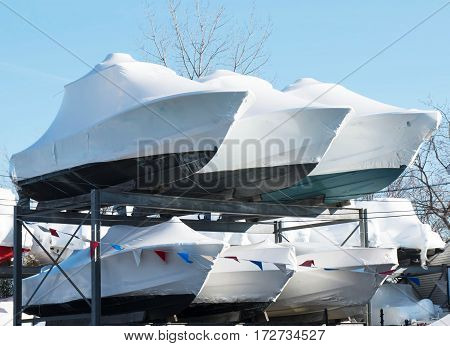 Boats stacked and stored on racks in the winter