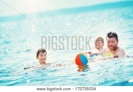 Father and son swimming at the sea. Man with a child having fun in the water