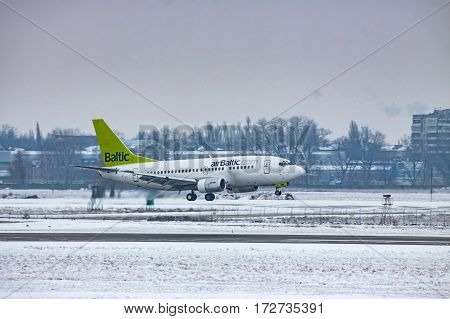 Borispol Ukraine - January 6 2011: airBaltic Boeing 737 landing on a cold winter day