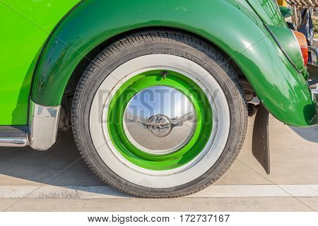 Bangkok Thailand -February 11 2017: Close-up wheel and logo of classic beetle green Volkswagen the popular German car manufacture.