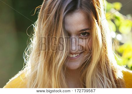cheeful and playful look of a blonde teenage woman
