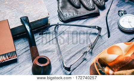 Smokers fashion set with tobacco pipe, eye glasses and pocket watch