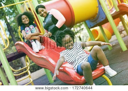 Happiness family holiday at playground