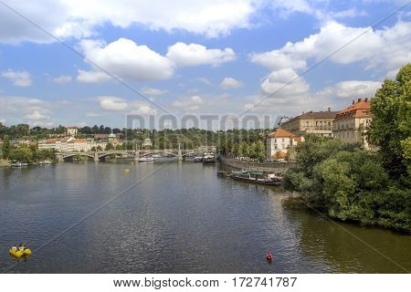 Old Town architecture and Charles Bridge over Vltava river in Prague .