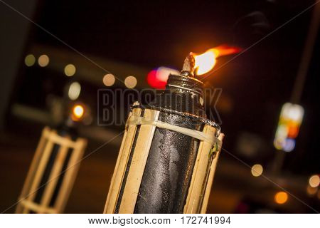 Lantern and flame in bokeh and suggestive background