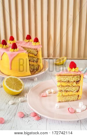 cooking lemon cake on wooden background close up