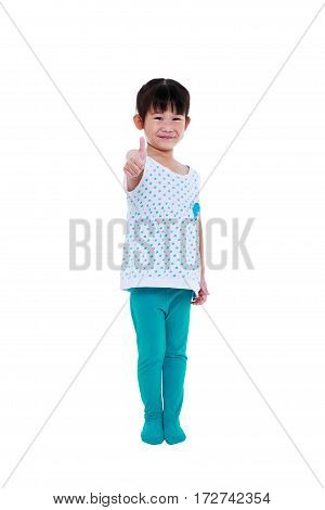 Full body. Adorable asian girl smiling and showing thumbs up sign. Happy child looking at camera isolated on white background. Positive human emotion facial expression feeling reaction. Studio shot.