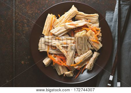 Asparagus and carrots in Korean and chopsticks horizontal