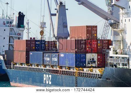 Labuan,Malaysia-May 11,2016:Shipping containers waiting to be loaded on a cargo ship in Labuan port,Malaysia on 11th May 2016.