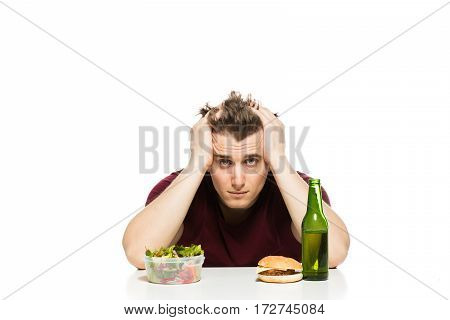 Healthy Versus Unhealthy Lifestyle, Man With Salad, Hamburger And Beer