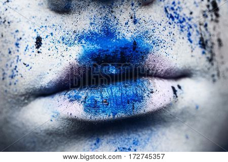 lips of woman with colorful powder make up. Beauty woman with bright blue makeup and white skin.  Abstract fantasy make-up, art design.