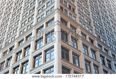 Tall building with lot of windows symmetric view