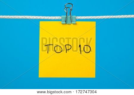 Yellow Paper Sheet On The String With Text Top 10