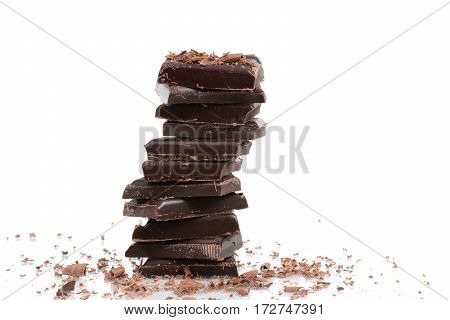 stacked dark chocolate pieces isolated white background