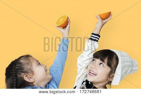 Two girls and fresh orange