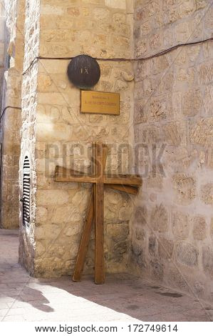 Station 9 Cross of Jesus Christ in Via Dolorosa Jerusalem Old City Israel. St. Helen coptic church. A big wooden cross on the ground