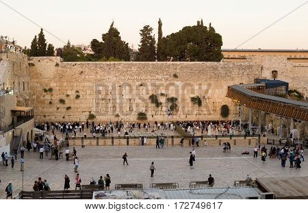 JERUSALEM ISRAEL - CIRCA SEP 2016: Local People and tourists pray at the western wall. Wailing Wall - part of the ancient wall around the Temple Mount in the Old City of Jerusalem