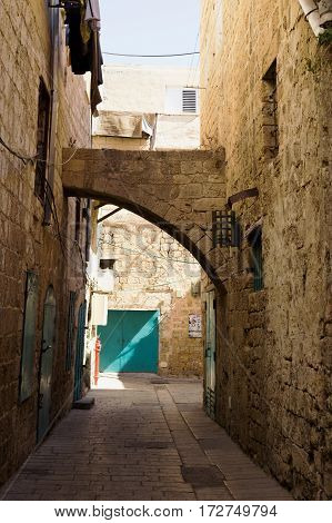 An alley in an ancient old city Acre Israel. Typical ancient oriental architecture. Day light