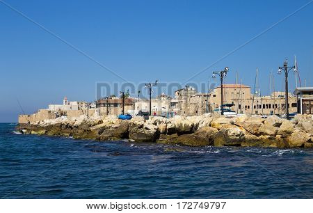 Embankment in old arabic city Akko (Acre) located north of Israel. Northern District Panoramic view from the sea side. Mediterranean sea