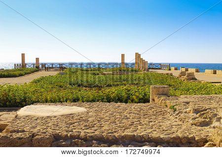 Columns of the ancient Roman Villa on the Mediterranean coast in Caesarea Israel. Nobody around. Beautiful landscape in a sunny day