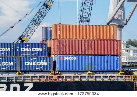 Labuan,Malaysia-May 11,2016::Stacked containers on the deck of cargo ship in Labuan port,Malaysia.Its a sheltered deep-water harbour which is an important transshipment point for Brunei Darussalam,Sarawak & Sabah