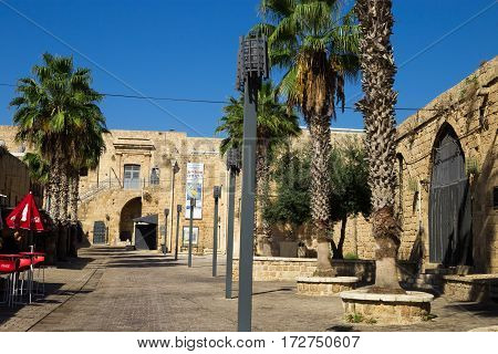ACRE ISRAEL - CIRCA SEP 2016: Inside of an Old city Acre (Akko). Old buildings palm trees and modern lights