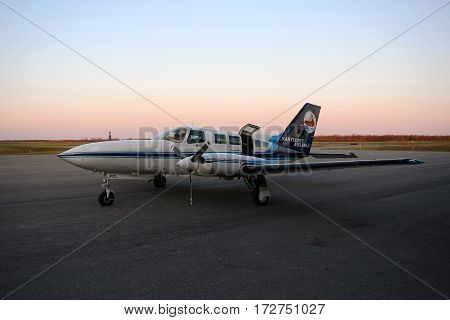 OGDENSBURG, NY, USA - MAY. 6, 2014: Nantucket Airlines Cessna 402C at sunset at Ogdensburg International Airport, Upstate New York, USA.