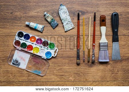 Art artistic squirrel brushes tubes of oil paints and watercolors on a wooden background.The palette of twenty-four colors .Used tools for artists and schoolchildren. Tools for art. Set of art tools