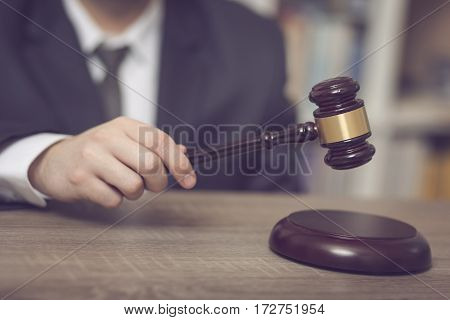 Detail of a judge in a courtroom making a verdict. Selective focus