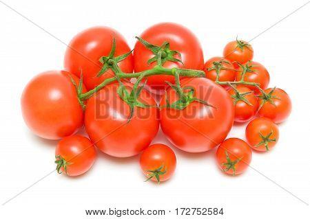 ripe tomatoes on a white background. horizontal photo.