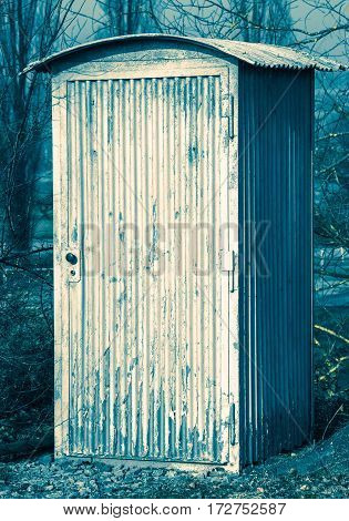 Weathered and rusty tool shed in an abstract colour look