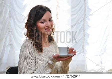 Girl drink first coffee in the morning. Student girl resting and enjoying before a hard day