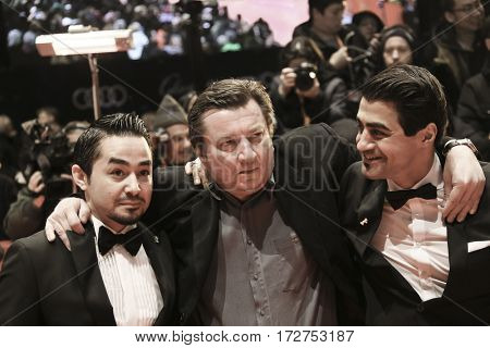 Sherwan Haji, director Aki Kaurismaki, Simon Hussein Al-Bazoon arrive for the closing ceremony of the 67th Berlinale  Festival Berlin at Berlinale Palace on February 18, 2017 in Berlin, Germany.