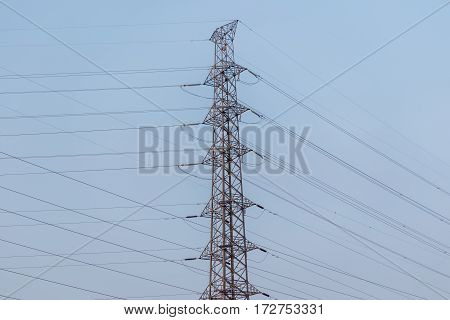 high voltage post.High-voltage tower in blue sky .