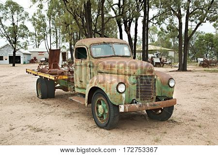 MILES, AUSTRALIA - MARCH 21, 2015: Old rusty wrecked truck