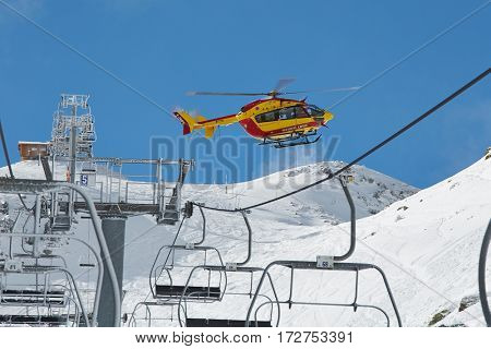 CHAMROUSSE, FRANCE - JANUARY 27, 2014: Rescue helicopter coming to an avalanch site.