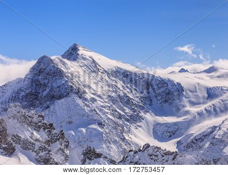 Alps, view from Mt. Titlis in Switzerland in winter. The Titlis is a mountain, located on the border between the Swiss cantons of Obwalden and Bern.