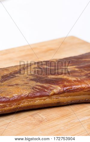 Whole Smoked Bacon On The Wooden Board