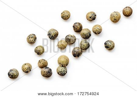 French green or le puy lentils scattered.  Isolated on white, top view.