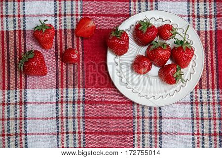 Red Fresh Strawberries on the Ceramic White Plate on the Check Tablecloth.Breakfast Organic Healthy Tasty Food.Cooking Vitamins Ingredients.Summer Fruits.Top View
