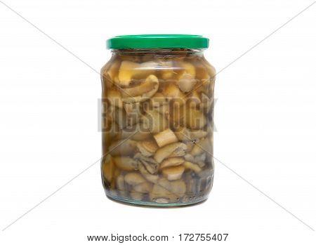 marinated mushrooms in the glass jars on white background. horizontal photo.