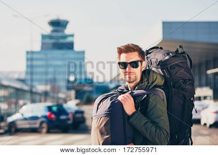 Portrait of the young traveler with backpack at the airport. Prague Czech Republic.