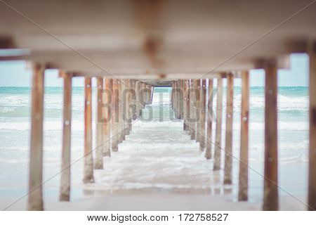 Landscape of a wooden bridge in the port and the sea front.