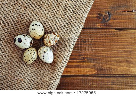 Useful quail eggs. Top view. The concept of healthy eating and vegetarianism.